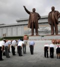 North Koreans bow in front of bronze statues of the late leaders Kim Il Sung, left, and Kim Jong Il at Munsu Hill, Monday, July 27, 2015, in Pyongyang, North Korea. North Koreans gathered to offer flowers and pay their respects to their late leaders as part of celebrations for the 62nd anniversary of the armistice that ended the Korean War. (AP Photo/Wong Maye-E)