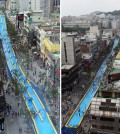 People enjoy riding a 350-meter-long waterslide on a street in Seoul's Seodamun Ward on July 19, 2015. The ward office operated the waterslide, the longest one in South Korea, in a festival aimed at helping people cool down in the summer heat. (Yonhap)