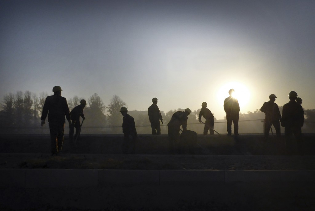 "North Korean Soldiers are silhouetted against the rising sun as they work on the new building structure of the Sunan International Airport, Tuesday, Oct. 28, 2014 in Pyongyang, North Korea. The new airport, which is now in its final stages, is the latest of North Korea's ""speed campaigns"", mass mobilisations of labor shock brigades aimed at finishing top-priority projects in record time. (AP Photo/Wong Maye-E)"