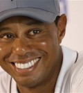 Tiger Woods smiles as he answers a question during a news conference prior to the start of the Quicken Loans National golf tournament at the Robert Trent Jones Golf Club in Gainesville, Va., Tuesday, July 28, 2015. (AP Photo/Steve Helber)
