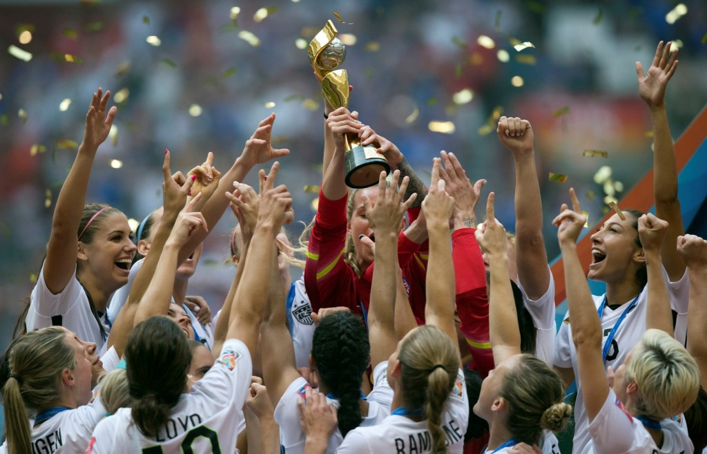 The United States Women's National Team celebrates with the trophy after they defeated Japan 5-2 in the FIFA Women's World Cup soccer championship in Vancouver, British Columbia, Canada, Sunday, July 5, 2015. (Darryl Dyck/The Canadian Press via AP)