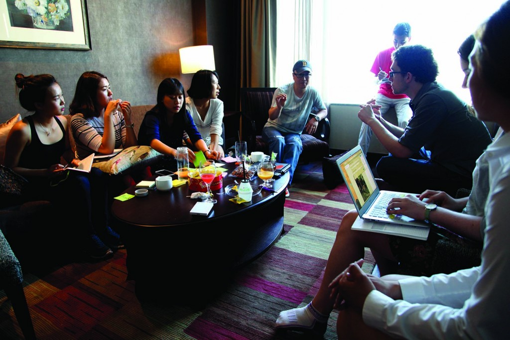 Christopher H.K. Lee has a production meeting and discussion with students. (Courtesy of Christopher H.K. Lee)