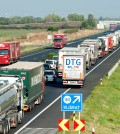 A long queue of vehicles waits on the M1 motorway near the border between Hungary and Austria near Mosonmagyarovar, 158 km northwest from Budapest, Hungary, Monday, Aug. 31, 2015. The line has reached 20 kilometers as every vehicle capable of smuggling people is checked at the border after 71 migrants were found dead in a truck Thursday. (Csaba Krizsan/MTI via AP)