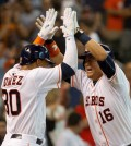 Houston Astros' Hank Conger, right, celebrates with Carlos Gomez after hitting a grand slam in the fourth inning of an MLB baseball game Saturday, Aug. 1, 2015. (Jason Fochtman/Conroe Courier via AP)