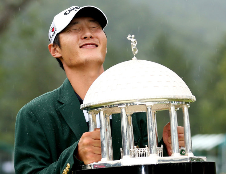 Danny Lee poses with the trophy after winning the Greenbrier Classic golf tournament at Greenbrier Resort in White Sulphur Springs, W.Va., Sunday, July 5, 2015. (AP Photo/Chris Tilley)