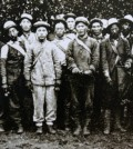 Korean immigrants who worked at an orange farm, including Dosan Ahn Chang-ho, second from left in front row, got together to pose for a photo. It is believe to be taken at Alta Cresta Grove Farm in Riverside, California. (Korea Times file)