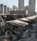 Damaged cars stand in China's northeast port city of Tianjin on Aug. 12, 2015 after suffering a series of huge explosions. While the exact cause of the explosions was not immediately known, South Korea's top carmaker Hyundai Motor is estimated to have lost 160 billion won (US$136 million) from the incident, which will be covered by its insurance. (Yonhap)