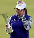 Tears of joy -- Inbee Park of South Korea wipes away tears holding the trophy after winning the Women's British Open golf championship at the Turnberry golf course in Turnberry, Scotland, Sunday, Aug. 2, 2015. (AP Photo/Scott Heppell)