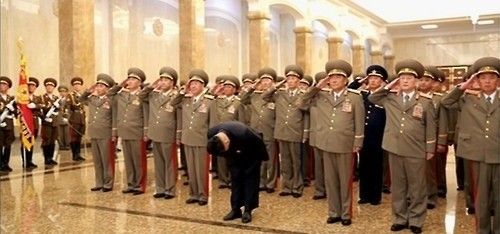 This photo captured from North Korean state television shows the country's leader, Kim Jong-un (front), and North Korean military officials paying their respects to Kim's late grandfather, Kim Il-sung, and late father, Kim Jong-il, at the Kumsusan Memorial Palace in Pyongyang on Aug. 15, 2015. (Yonhap)