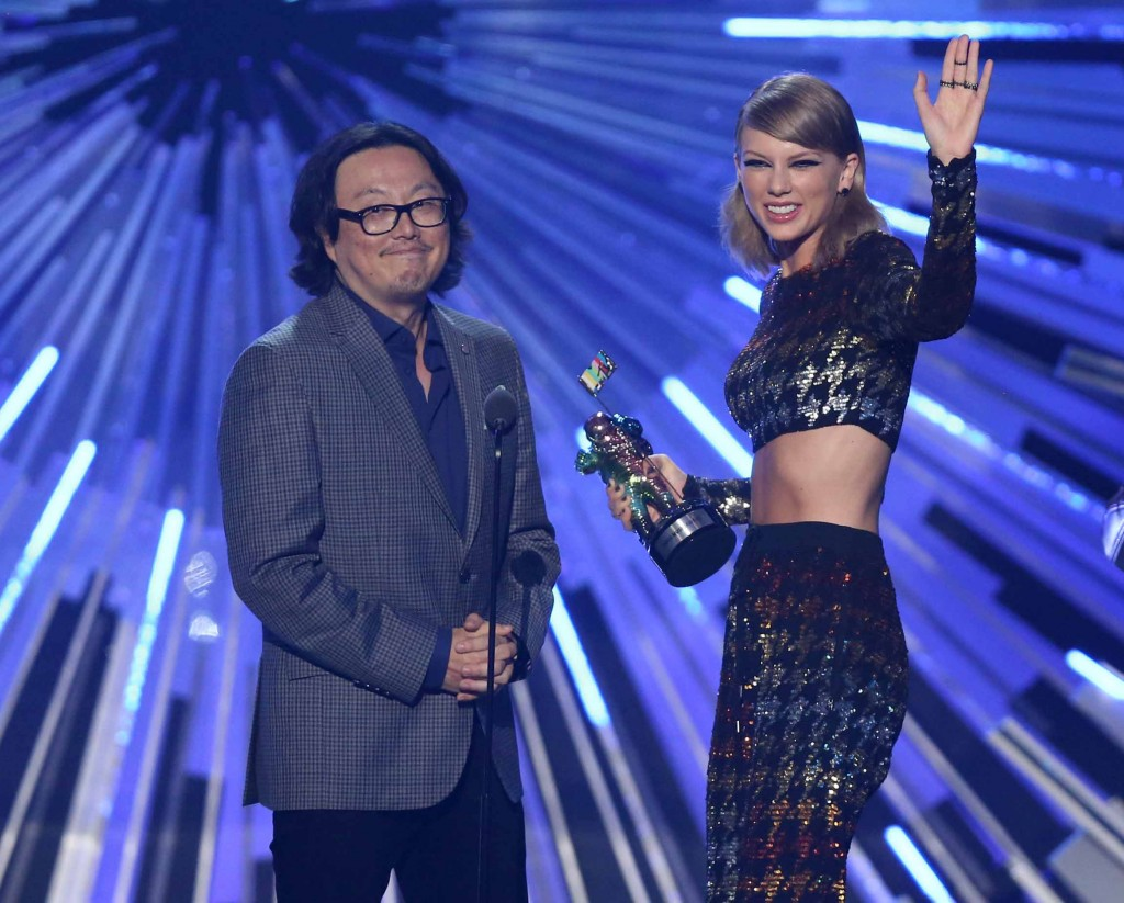 "Director Joseph Kahn, left, and Taylor Swift appear on stage after Swift accepts the award for female video of the year for ""Blank Space"" at the MTV Video Music Awards at the Microsoft Theater on Sunday, Aug. 30, 2015, in Los Angeles. (Photo by Matt Sayles/Invision/AP)"