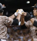 Pittsburgh Pirates' Neil Walker (18) is greeted by Jung Ho Kang after driving him in with a two-run home run during the sixth inning of a baseball game against the San Francisco Giants, Thursday, Aug. 20, 2015, in Pittsburgh. (AP Photo/Keith Srakocic)