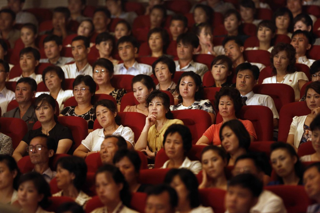 Spectators watch a performance by Slovenian rock band Laibach at a theater in Pyongyang, North Korea, Wednesday, Aug. 19, 2015. It's rare for North Korea to allow modern music from abroad to be performed inside the country. (AP Photo/Dita Alangkara)