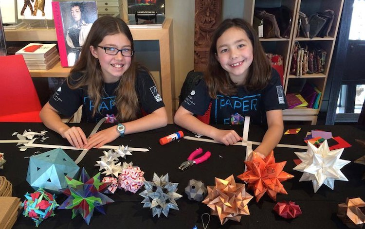 Isabelle Adams, left, with her sister Katherine have raised over $650,000 through origami to build wells for Ethiopian villages in need. (Courtesy of Facebook)