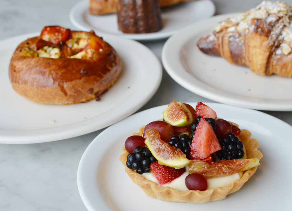 Fruit tart, bottom right, savory brioche with feta and tomato, top left, at Proof Bakery in Atwater Village. (Tae Hong/Korea Times)