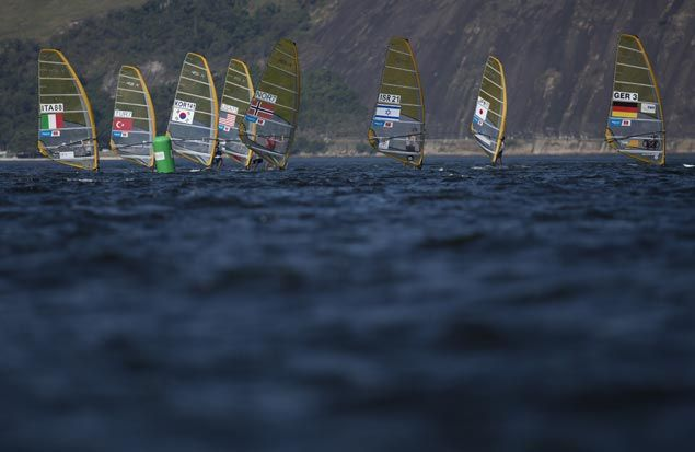 Men compete in the RS:X Windsurfer event during a sailing test, ahead of the Rio 2016 Olympic Games, in Guanabara Bay in Rio de Janeiro, Brazil, Saturday, Aug. 15, 2015. (AP Photo/Leo Correa)