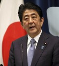 """Japanese Prime Minister Shinzo Abe delivers a statement to mark the 70th anniversary of the end of World War II during a press conference at his official residence in Tokyo Friday, Aug. 14, 2015. Abe has expressed """"profound grief"""" for all who perished in World War II in a statement marking the 70th anniversary of the country's surrender. (AP Photo/Eugene Hoshiko)"""