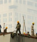 FILE - In this June 16, 2015, file photo, laborers work on a smoggy day in Beijing. A new study shows that air pollution is killing about 4,000 people in China a day, accounting for 1 in 6 premature deaths in the world's most populous country. (AP Photo/Mark Schiefelbein, File)
