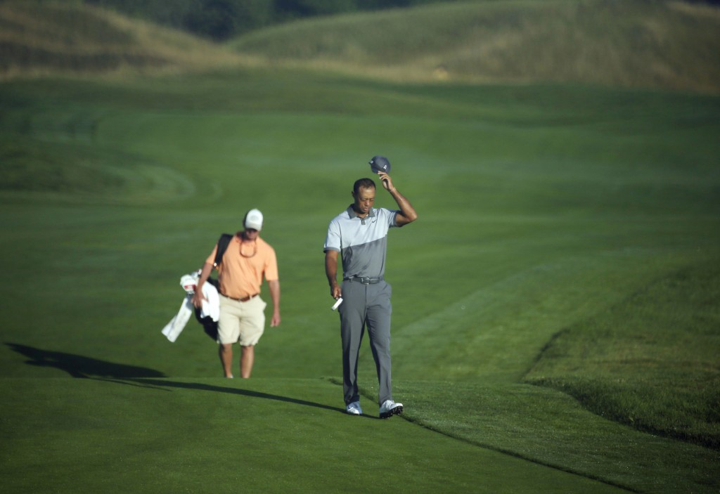 Tiger Woods walks up the first hole during a practice round for the PGA Championship golf tournament Tuesday, Aug. 11, 2015, at Whistling Straits in Haven, Wis. (AP Photo/Chris Carlson)