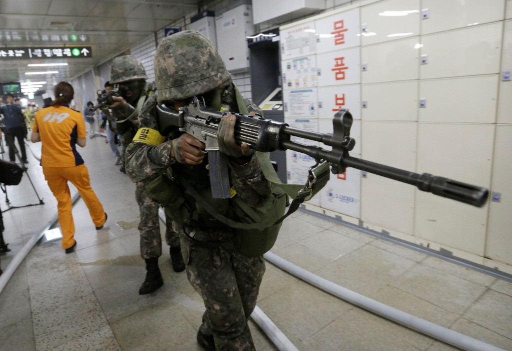 South Korean army soldiers aim their weapons during an anti-terror drill as part of Ulchi Freedom Guardian exercise, at Sadang Subway Station in Seoul, South Korea, Wednesday, Aug. 19, 2015. U.S. and South Korean forces launched Monday an annual joint military exercises, Ulchi Freedom Guardian, for a 12-day run to prepare for a possible North Korea's attack. (AP Photo/Ahn Young-joon)