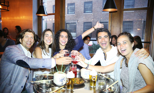 A group of New Yorkers dine and drink inside Soju Haus in Manhattan's Koreatown. (Chun Ji-hoon/Korea Times)