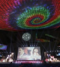 A screen shows Afghanistan actress Marina Golbahari, right, and South Korean actor Song Kang-ho on the eve of the opening ceremony of the Busan International Film Festival at Busan Cinema Center in Busan, South Korea. Wednesday, Sept. 30, 2015. Asia's largest movie festival kicks off Thursday at a time when the region's influence on the global movie industry is on the rise. (AP Photo/Ahn Young-joon)