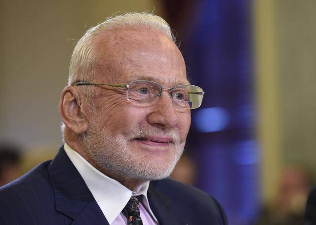 Buzz Aldrin, former NASA Astronaut and Apollo 11 Pilot, arrives on Capitol Hill in Washington to testify before the Senate subcommittee on Space, Science, and Competitiveness hearing on human exploration goals and commercial space competitiveness. (AP Photo/Susan Walsh)