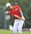 Danny Lee chips to the green on the 17th hole in the final round of the Tour Championship golf tournament at East Lake Golf Club, Sunday, Sept. 27, 2015, in Atlanta. Lee finished a three-way tie for second place with at 5 under par. (AP Photo/John Amis)