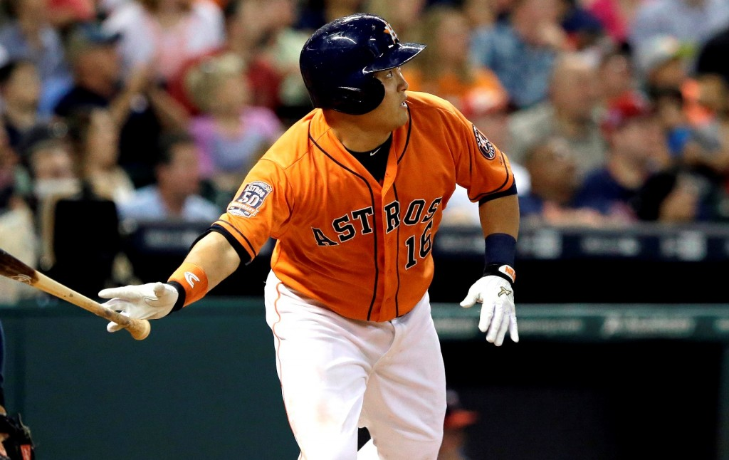 Houston Astros' Hank Conger watches the ball go over the wall for a grand slam against the Minnesota Twins in the fourth inning of a baseball game Friday, Sept. 4, 2015, in Houston. (AP Photo/Pat Sullivan)