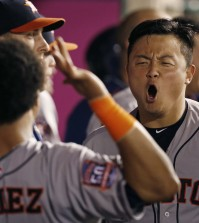 Houston Astros' Hank Conger is congratulated after hitting a solo home run in the seventh inning of a baseball game against the Los Angeles Angels in Anaheim, Calif., Saturday, Sept. 12, 2015. (AP Photo/Christine Cotter)