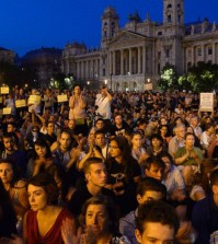 Supporters and activists of the Migration Aid civil group hold a demonstration in support of migrants at Kossuth Square, in front of the Hungarian Parliament building in Budapest, Hungary, Wednesday, Sept. 2, 2015. Over 150,000 migrants have reached Hungary this year, most coming through the southern border with Serbia. Many apply for asylum but quickly try to leave for richer EU countries. (Noemi Bruzak/MTI via AP)