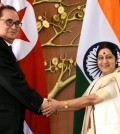 In this Monday, April 13, 2015 file photo, Indian Foreign Minister Sushma Swaraj, right, shakes hands with North Korea's Foreign Minister Ri Su Yong in New Delhi, India. Ties are warming between New Delhi and Pyongyang, with mineral-hungry India looking to boost trade while North Korea, facing sometimes-rocky relations with China, searches for new friends. The goodwill began earlier this year, when North Korea dispatched Ri on a three-day trip to India, just a few weeks before Prime Minister Narendra Modi flew to Seoul for meetings with South Korean President Park Geun-hye. (AP Photo/Manish Swarup, File)