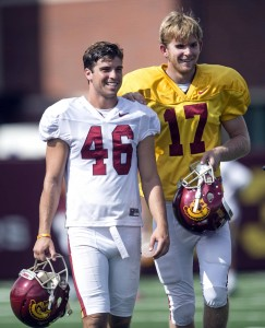 USC's Reid Budrovich, left, guides teammate Jake Olson, through the field during practice at Howard Jones Field in Los Angeles. Jake Olson, the blind long snapper from Orange Lutheran High, participated in his first practice as a member of the USC football team Tuesday, Sept. 15, 2015. (Ed Crisostomo/The Orange County Register via AP)