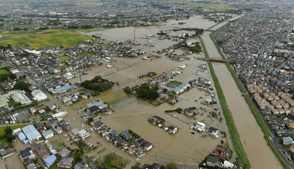 Houses are flooded due to heavy rain in Koshigaya, Saitama prefecture, near Tokyo Thursday, Sept. 10, 2015. Heavy rain is pummeling Japan for a second straight day, overflowing rivers and causing landslides and localized flooding in the eastern part of the country. (Kyodo News via AP Photo)