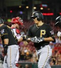 Pittsburgh Pirates' Kang Jung-ho, center right, runs to the dugout with Gregory Polanco, left, Aramis Ramirez, center left, and Andrew McCutchen, right, after hitting a grand slam off Cincinnati Reds starting pitcher Keyvius Sampson during the sixth inning of a baseball game, Wednesday, Sept. 9, 2015, in Cincinnati. (AP Photo/John Minchillo)