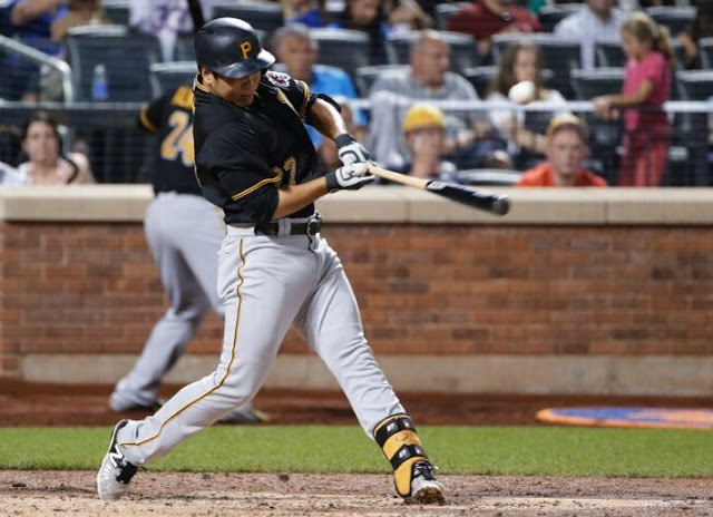 Pittsburgh Pirates' Jung Ho Kang hits a single during the fourth inning of a baseball game against the New York Mets on Friday, Aug. 14, 2015, in New York. (AP Photo/Frank Franklin II)