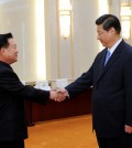 In this May 24, 2013, file photo released by China's Xinhua News Agency, North Korean Vice Marshal Choe Ryong Hae, left, is greeted by Chinese President Xi Jinping in Beijing when the top North Korean envoy delivered a letter from leader Kim Jong Un to Xi and told him Pyongyang would take steps to rejoin stalled six-nation nuclear disarmament talks. If North Korea launches a rocket into space or conducts a nuclear test in the coming weeks, marking the 70th anniversary of the founding of its ruling Workers Party on Oct. 10, 2015, as observers suspect it may, China is certain to respond angrily, and perhaps with an unprecedented level of economic punishment. (Rao Aimin/Xinhua News via AP)