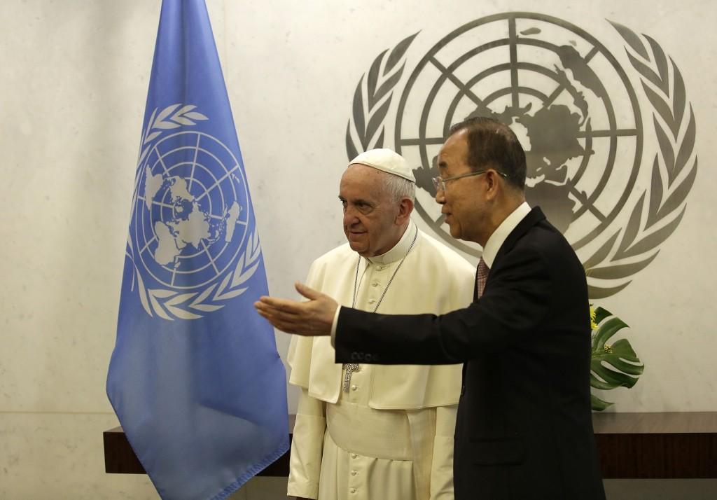 Pope Francis, left, talks with United Nations Secretary Ban Ki-moon at the United Nations headquarters, Friday, Sept. 25, 2015. (Joshua Lott/Pool Photo via AP)