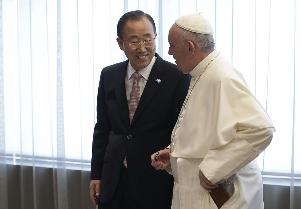 Pope Francis talks with United Nations Secretary Ban Ki-moon at the United Nations headquarters, Friday, Sept. 25, 2015. (Joshua Lott/Pool Photo via AP)