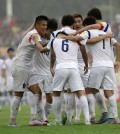South Korea's Kwon Chang-hoon, center, celebrates with his teammates scoring his side's third goal during the World Cup Group G qualification soccer match between Lebanon and South Korea in the southern port city of Sidon, Lebanon, Tuesday, Sept. 8, 2015. (AP Photo/Hassan Ammar)