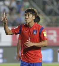 South Korea's Son Heung-min celebrates scoring a hat-trick against Laos during the Asian zone Group G qualifying soccer match for the 2018 World Cup at  Hwaseong Sports Complex Main Stadium in Hwaseong, South Korea, Thursday, Sept. 3, 2015. South Korea won 8-0.(AP Photo/Ahn Young-joon)