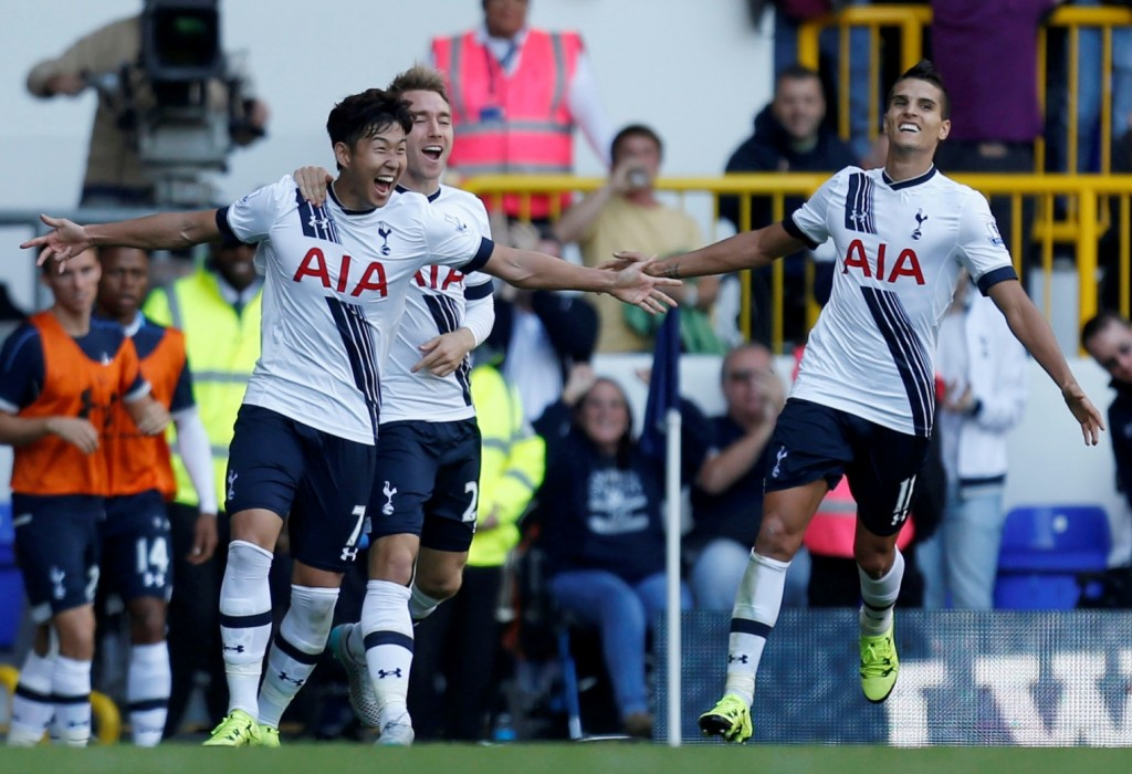 Tottenham Hotspur's Heung-Min Son, left, celebrates with Christian Eriksen and Erik Lamela, right, after scoring his side's first goal of the game against Crystal Palace during their English Premier League match at White Hart Lane, London, Sunday Sept. 20, 2015. (Paul Harding/PA via AP)