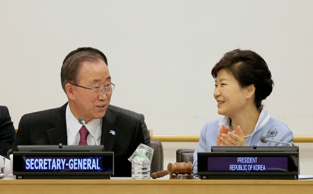 United Nations Secretary General Ban Ki-moon, left, talks with South Korea president Park Geun-hye during a conference on A New Rural Development Paradigm and the Inclusive Sustainable New Communities Model, Saturday, Sept. 26, 2015, at the United Nations headquarters. (AP Photo/Julie Jacobson)