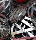 Volkswagen ornaments sit in a box in a scrap yard in Berlin, Germany, Wednesday, Sept. 23, 2015. The revelation that Volkswagen rigged diesel-powered cars to emit lower emissions during EPA tests is particularly stunning since Volkswagen has long projected a quirky brand image with an emphasis on being environmentally friendly -- an image that now appears in tatters. (AP Photo/Michael Sohn)