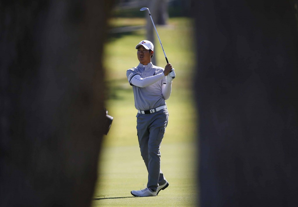 D.H. Lee of South Korea hits from the fairway on the ninth hole during the first round of the Shriners Hospitals for Children Open golf tournament Thursday, Oct. 22, 2015, in Las Vegas. (AP Photo/Isaac Brekken)