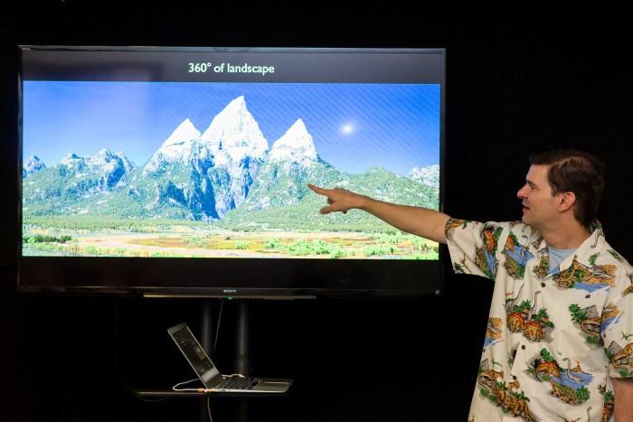 "Set Supervisor for Pixar's upcoming film ""The Good Dinosaur"" at Pixar headquarters in Emeryville, Calif. explaining how the studio used U.S. Geological Survey data to create sets for the film. (Courtesy of Pixar/Disney)"