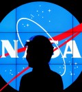 South Korean President Park Geun-hye walks past a NASA logo during a tour of projects and programs that are underway at the agency's Goddard Space Flight Center, Wednesday, Oct. 14, 2015, in Greenbelt, Md. (AP Photo/Patrick Semansky)