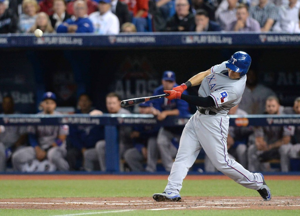 Texas Rangers' Choo Shin-soo hits a home run against the Toronto Blue Jays during the third inning in Game 5 of baseball's American League Division Series, Wednesday, Oct. 14, 2015 in Toronto. (Chris Young/The Canadian Press via AP)