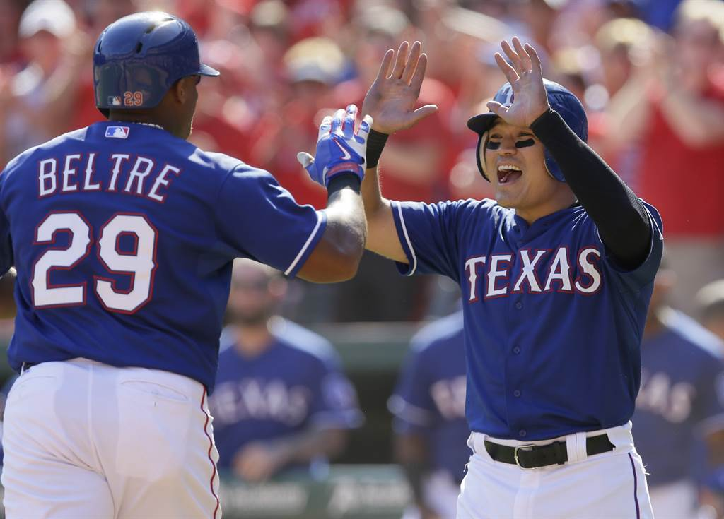 Texas Rangers Adrian Beltre (29) celebrates his two run home run with teammate Shin-Soo Choo, of South Korea, during the sixth inning of a baseball game against the Los Angeles Angels in Arlington, Texas, Sunday, Oct. 4, 2015. Choo also scored on the play. (AP Photo/LM Otero)