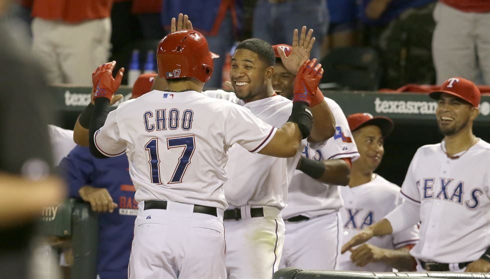 Texas Rangers Shin-Soo Choo (17) of South Korea celebrates his solo home run with teammate Elvis Andrus during the fourth inning of a baseball game against the Los Angeles Angels in Arlington, Texas, Friday, Oct. 2, 2015. (AP Photo/LM Otero)