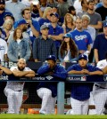 Los Angeles Dodgers watch from the dugout during the ninth inning against the New York Mets in Game 5 of baseball's National League Division Series Thursday, Oct. 15, 2015, in Los Angeles. The Mets won 3-2. (AP Photo/Lenny Ignelzi)